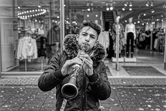THE YOUNG STREET MUSICIAN (NorbertPeter) Tags: man street people young hilden germany spontaneous music outdoor city urban sony ilce7 monochrome streetphotography blackandwhite bw streetportrait streetmusician portrait