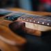 Closeup of electric guitar body and neck. Charvel San Dimas Hawaiian koa