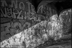 concrete foundation, railroad bridge, graffiti, urban decay, Asheville, NC, Minolta XG-M, Super Albinon, Derev Pan 400, HC-110 developer, 11.13.19 (1 of 1) (steve aimone) Tags: foundation concrete bridge railroadbridge graffiti urbanlandscape urbandecay asheville northcarolina minoltaxgm superalbinon28mmf28 primelens derevpan400 hc110developer 35mm 35mmfilm film monochrome monochromatic blackandwhite