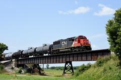 CN L572 Rises Above it All (GRNDMND) Tags: trains railroads canadiannational cn locomotive emd sd60 loveland iowa