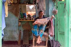 Reader (Karunyaraj) Tags: reader newspaper kolkatta westbengal india morning barber shop nikkor24120 d610 cwc742