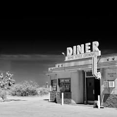 home style cooking. mojave desert, ca.  2011. (eyetwist) Tags: eyetwistkevinballuff eyetwist diner mojavedesert california nikkor nikon d7000 nikond7000 18200mmf3556gvrii 18200mm square bw black white monochrome blackwhite processed postprocessed plugin alienskinexposure niksilverefex contrast americana roadsideamerica weathered type typography typographic classic vintage retro socal graphic font signage arrow lunch special parking joshuatree movie set filming 4aces location lakelosangeles food