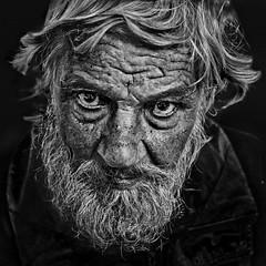 Alone on the streets (Ales Dusa) Tags: man homeless portrait outdoor streetshot candid wrinkles beard oldbeardedman alesdusa people human humanity bwportrait blackandwhite strongcontrast charisma moustache eyetoeye canon expressiveeyes fullframe detailedportrai texture blackbackground