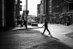 Crossing (Leanne Boulton) Tags: urban street candid streetphotography candidstreetphotography streetlife urbanlandscape man male walking stride step shape form silhouette contrejour backlight rimlight lines composition sunlight winter tone texture detail depth naturallight outdoor light shade shadow city scene human life living humanity society culture lifestyle people canon canon5dmkiii 70mm ef2470mmf28liiusm black white blackwhite bw mono blackandwhite monochrome glasgow scotland uk