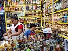 Mexico. Selling licquor in the Oaxacan central market (mountaintrekker2001) Tags: mexico mexicancolonialcities oaxacan market oaxaca