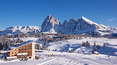 IMGP3711 Sonne hotel and Dolomites panorama (Claudio e Lucia Images around the world) Tags: alpedisiusi valgardena dolomiti alpe di siusi val gardena snow winter mountains adler lodge ortisei sassolungo sassopiatto sky christ cross pentax pentaxk3ii pentaxcamera pentaxlens pentaxart cold unesco pentax18135 gröden sciliar clouds tree sella sellagroup sonne sole hotel