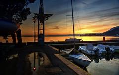 Tramonto (giannipiras555) Tags: porto tramonto luce sole barche orizzonte colline cielo nuvole lago garda