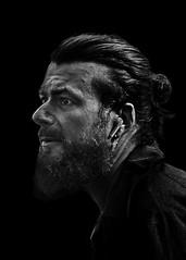 Portrait (D80_547362) (Itzick) Tags: candid copenhagen bw beard man face facialexpression blackbackground streetphotography denmark d800 itzick
