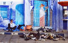 Vendor, Chefchouan (klauslang99) Tags: klauslang travel photography chefchouan morocco salesman vendor wall mural shoes