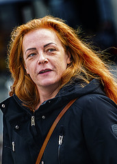 Portrait (D80_547370) (Itzick) Tags: redhead redhair woman longhair streetphotography face facialexpression portrait denmark d800 itzick candid copenhagen