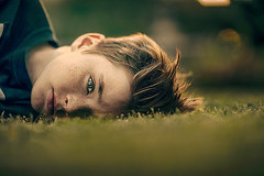 Worry ({jessica drossin}) Tags: wwwjessicadrossincom jessicadrossin face freckles boy hair details grass green worry
