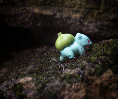 A Bulbasaur ventures out of the undergrowth (Jezbags) Tags: bulbasaur undergrowth nintendo toy toys toyphotography pokemon canon canon80d 80d 100mm macro macrophotography macrodreams