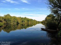 Karlovac, Croatia - Reflections on river Korana (Marin Stanišić Photography) Tags: karlovac croatia karlovaccounty boat reflection afternoon river korana olympus e410