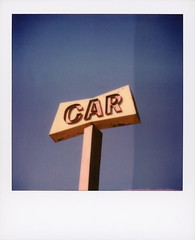At The Car... (tobysx70) Tags: polaroid originals color sx70 expired instant film sx70sonar sonar tele15 lens at the car wash prospect avenue east hollywood los angeles la california ca neon sign red yellow blue sky rose royce song toby hancock photography