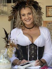 Woman, White Blouse and Corset (Ron Scubadiver's Wild Life) Tags: people portrait feather costume renfest outdoor texas renaissance festival nikon 70300afp