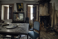 "Haunted by the ""crying boy"" (JG - Instants of light) Tags: creepyhouse livingroom diningroom furniture fireplace abandoned forgotten decay spooky scaryplace ghosts haunted cobwebs dust casaassustadora saladeestar saladejantar mobília lareira abandonado esquecido decadência assustador lugarassustador fantasmas assombrada teiasdearanha pó urbex exploraçãourbana lugaresabandonados lugaresassombrados passadoesquecido lugaresperdidos urbanexploration abandonedplaces hauntedplaces forgottenpast lostplaces nikon d5500 sigma 1020 portugal"
