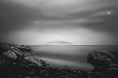 SadFlow_11 (SadFo_x1) Tags: rock water sea aegean greece samos travel nature natureisanartist beach remembrance landscape hill mount mountain sky clouds cloud mystery light bw blackandwhite black white camera