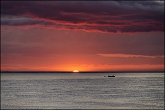 Another Different Sunrise   Blanes, Catalonia (Flemming J. Gade) Tags: sunrise sun clouds red orange boat sea sky blanes catalonia