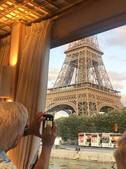 Glimpse of Paris (Melinda * Young) Tags: eiffeltower man cellphone camera view window cruiser ship boat seineprincess cruising seine river sightseeing photographer travel monument icon paris symbol iron engineering tower