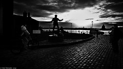 The Sound of Fury. (Neil. Moralee) Tags: neilmoralee billy fury ronald wycherley music pop rock silhouette dark mersey merseyside liverpool dock river beat singer statue neil moralee olympus omd em5 black white mono monochrome blackandwhite blackwhite bw blackbackground candid cobble street cobbles cobbled bicycle tourists people uk britain still life