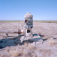 not the droid you're looking for. mojave desert, ca. 2019. (eyetwist) Tags: eyetwistkevinballuff eyetwist abandoned water pump farm mamiya 6mf kodak portra 400 mamiya6mf kodakportra400 50mm mamiya50mmf4l ishootfilm analog analogue film emulsion mamiya6 square 6x6 mediumformat 120 filmexif iconla lenstagger epsonv750pro ishootkodak mojave desert california mojavedesert highdesert medium format roadsideamerica americana typology dirt wasteland american west rural lancaster antelopevalley redman landscape bleak droid robot rusty starwars r2d2 agriculture irrigation well pipe