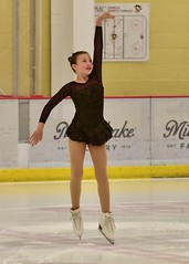 Cute pose (R.A. Killmer) Tags: young cute skate show ice lemieux center performer costume practice graceful nikon d750
