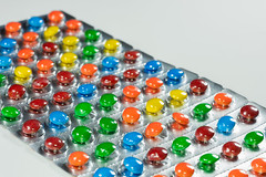 Drug Candy (si_glogiewicz) Tags: drugs drug candy candies big pharma pharmaceuticals pharmaceutical company pharmacy tablets medicine colour colorful sweets chocolate smarties foil tabs white background