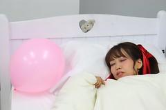 Dream On (emotiroi auranaut) Tags: girl woman lady asleep sleeping dream dreaming bunny rabbit bed pillow white sheets blankets pink balloon