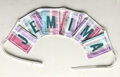 """Photo of Jemima in turquoise sequin letters on Designers Guild fabric. Designed specifically to match Jemima's postage stamp party invitations. Matching mini bunting being used as table name settings and """"OLDIES"""" bunting so they know where their table is located!"""