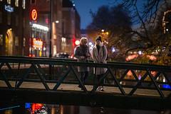 Uppsala, November 2, 2019 (Ulf Bodin) Tags: alltljuspåuppsala night sverige people streetphotography outdoor kväll nightphotography västgötaspången uppsala fyrisån canonrf85mmf12lusm fyrisriver sweden canoneosr brigde urbanlife uppsalalän