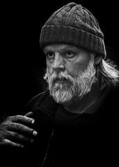Portrait (D80_547514) (Itzick) Tags: candid copenhagen bw bwportrait beard hat man blackbackground face facialexpression streetphotography portrait denmark d800 itzick