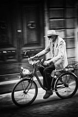 Street photography Italy (www.streetphotography-berlin.com) Tags: street streetphotography streetlife old man bicycle hat riding walking stick blackandwhite blackwhite urban monochrome fineart