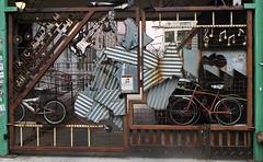 Gate (neilsonabeel) Tags: nikonfm2 nikon nikkor film streetart welded bike sculpture gate street analogue guitar