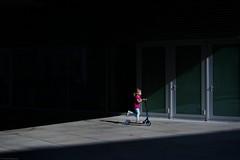 Street life - Chorzów 2019 (Tu i tam fotografia) Tags: street ulica streetlife sun light światło słońce streetphotography fotografiauliczna streetphoto człowiek man people girl polska poland outdoor candid dark doors door drzwi hulajnoga sunbeam scooter kid miasto city shadow cień summer lato