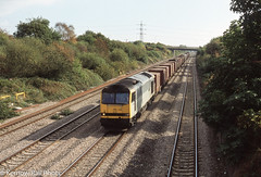 Saturday Steel (Kernow Rail Phots) Tags: class60 60028 johnflamsteed bishton gwent southwales newport 6v05 0955 so roundoak llanwern empty steel train trains freight goods saturday 11th october 2003 2000s 11102003 gb uk britain wales monmouthshire triple grey livery trees bridge fourtrack track sunny brush traction loughborough