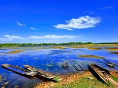 Nong Wai scenes - หนองหวาย 8e (SierraSunrise) Tags: thailand phonphisai nongkhai isaan esaen pond swamp nong reservoir boat reflections clouds