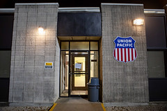 Union Pacific rail yard office building (ezeiza) Tags: kansas ks coffeyville unionpacificrailroad unionpacific union pacific up railroad railway railyard rail yard night light sign shield office building bldg 3945 entrance door window