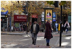 Don't stare!.. Quick look away she's taking pics! (joanneharlow70) Tags: manchester people man women children crossing walking lights advertising shops street urban city road pavement coats hats shopping bag trafficlights trees leaves bycicles bikes graffiti shadows sunlight