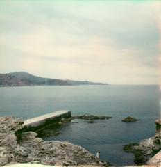 concrete pier (lawatt) Tags: pier concrete rocks sea sky mediterranean water banyulssurmer france film instant polaroid sx70