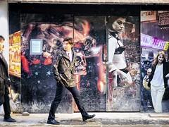 Entering the Tease Zone (garryknight) Tags: london iphone on1photoraw snapseed street soho man poster photo photograph woman graffiti streetart