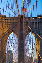 Morning at the Bridge... (Aleem Yousaf) Tags: travel d850 nikon nikkor usa new york big apple brooklyn bridge united states america city scape arches flag stars stripes frame morning light sunrise glow historic architecture 70200mm field view shallow down town manhattan east river september 2019 digital camera dslr flickr steel shadows
