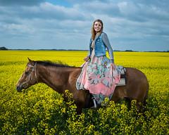 Prairie Afternoon (rskura) Tags: green fields yellow horse horseback dress rider canola clouds sky prairie country equine portrait justpentax strobist ricohpentax 645z girl denim vest saddle