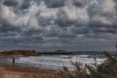 Le pêcheur !... (jmollien) Tags: pêcheur fisherman mer méditerrannée sea méditerraneansea vagues waves ciel sky nuages clouds phare lighthouse languedoc landscape plage