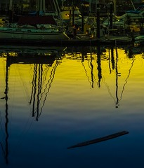 Marina flotsam at sunset (World-viewer) Tags: flickrtravelaward flickraward ngc award dock bay harbor flotsam boats boat marina marine city supershot plus iphone8plus iphone8 iphone mbpictures beautiful reflection water sunset explore wander travel
