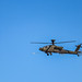 A U.S. Army AH-64 Apache attack helicopter fires an aerial rocket during gunnery qualification