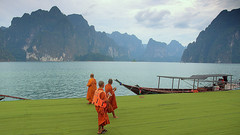 Monks with smartphones (Teresa (be there...)) Tags: national park thailand khaosok buddism orange color mountains lake water clouds nature monks boat mobile phone smartphone nikon d90