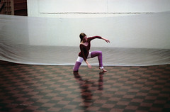 74-346 (ndpa / s. lundeen, archivist) Tags: nick dewolf nickdewolf color photographbynickdewolf 1975 1970s film 35mm 74 reel74 autumn fall cambridge massachusetts dance rehearsal dancerehearsal people dancing dancer rehearsing tiles tiled tiledfloor dancestudio woman youngwoman blond blonde ponytail fabric unitard tights studio leggings