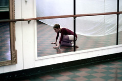 74-344 (ndpa / s. lundeen, archivist) Tags: nick dewolf nickdewolf color photographbynickdewolf 1975 1970s film 35mm 74 reel74 autumn fall cambridge massachusetts dance rehearsal dancerehearsal people dancing dancer rehearsing tiles tiled tiledfloor dancestudio woman youngwoman blond blonde ponytail fabric mirror mirrors rail railing unitard tights studio leggings