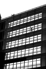 In the fourth corridor (pascalcolin1) Tags: paris13 homme man fenetres windows couloir corridor lumière light photoderue streetview urbanarte noiretblanc blackandwhite photopascalcolin 50mm canon50mm canon