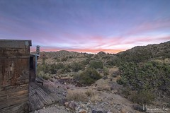 Shack Sunrise (magnetic_red) Tags: shack building house wood abandoned trash cans old sunrise sky clouds pink mountains desert mojave